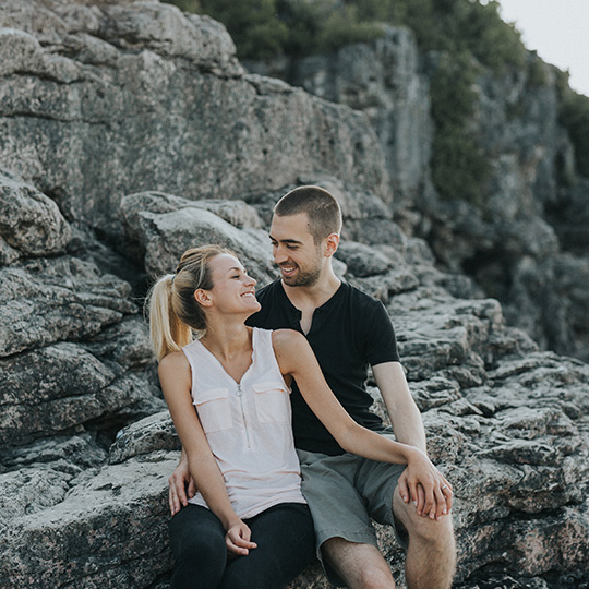 Smiling engaged couple in a grotto