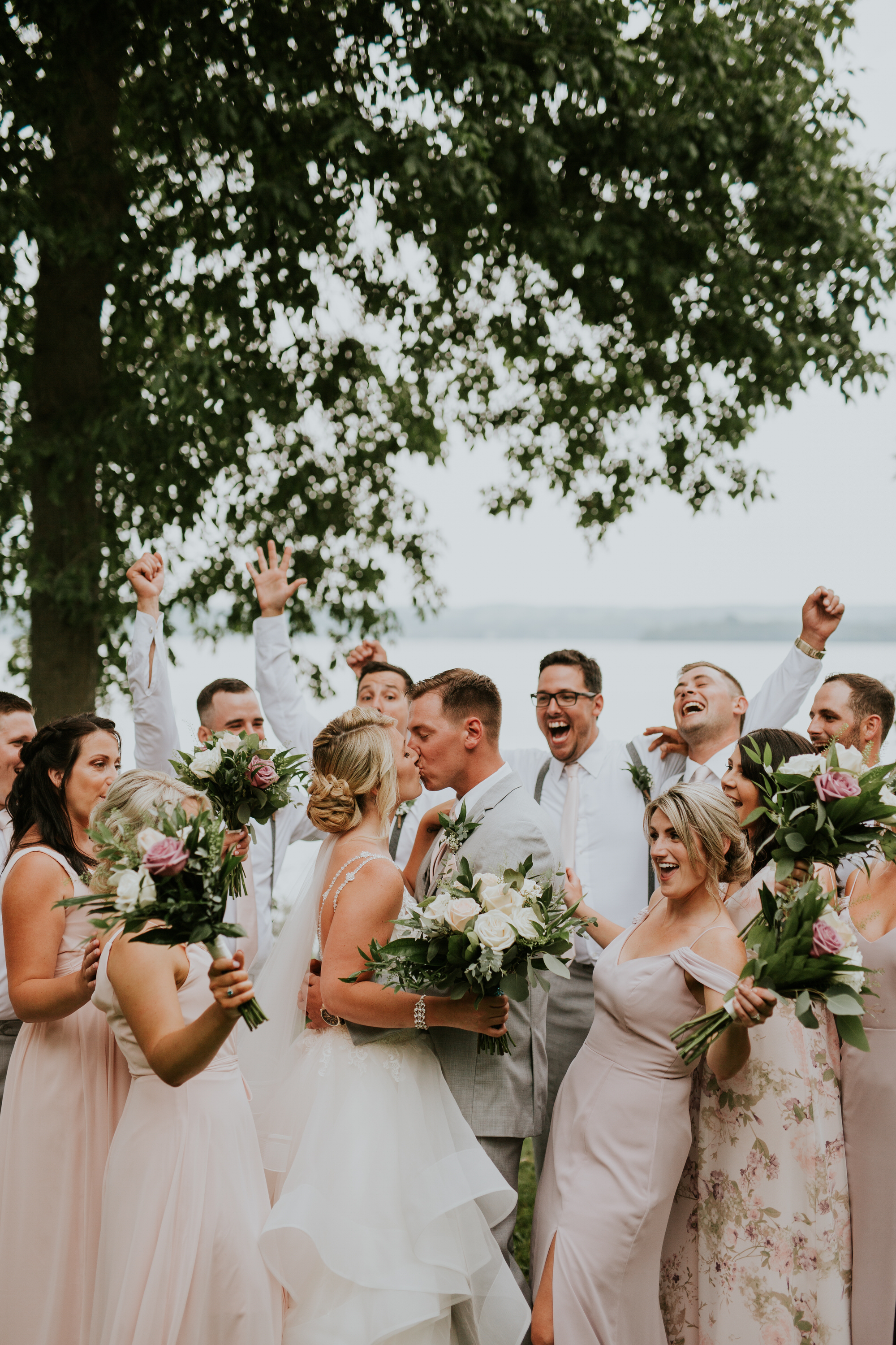 Elmhirst Resort Wedding - Bridal party kissing portrait