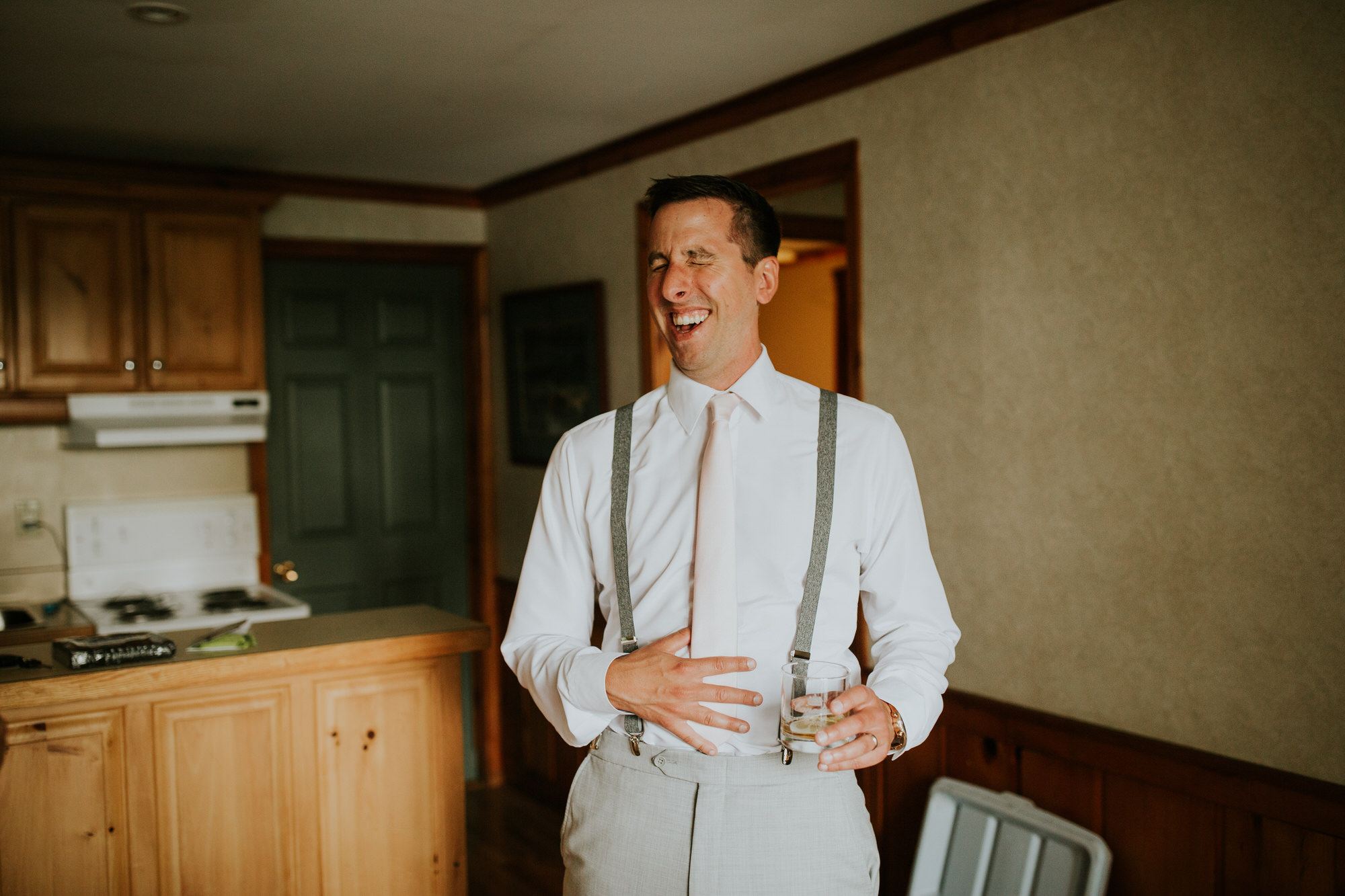 Elmhirst Resort Wedding - groom laughing during prepoep