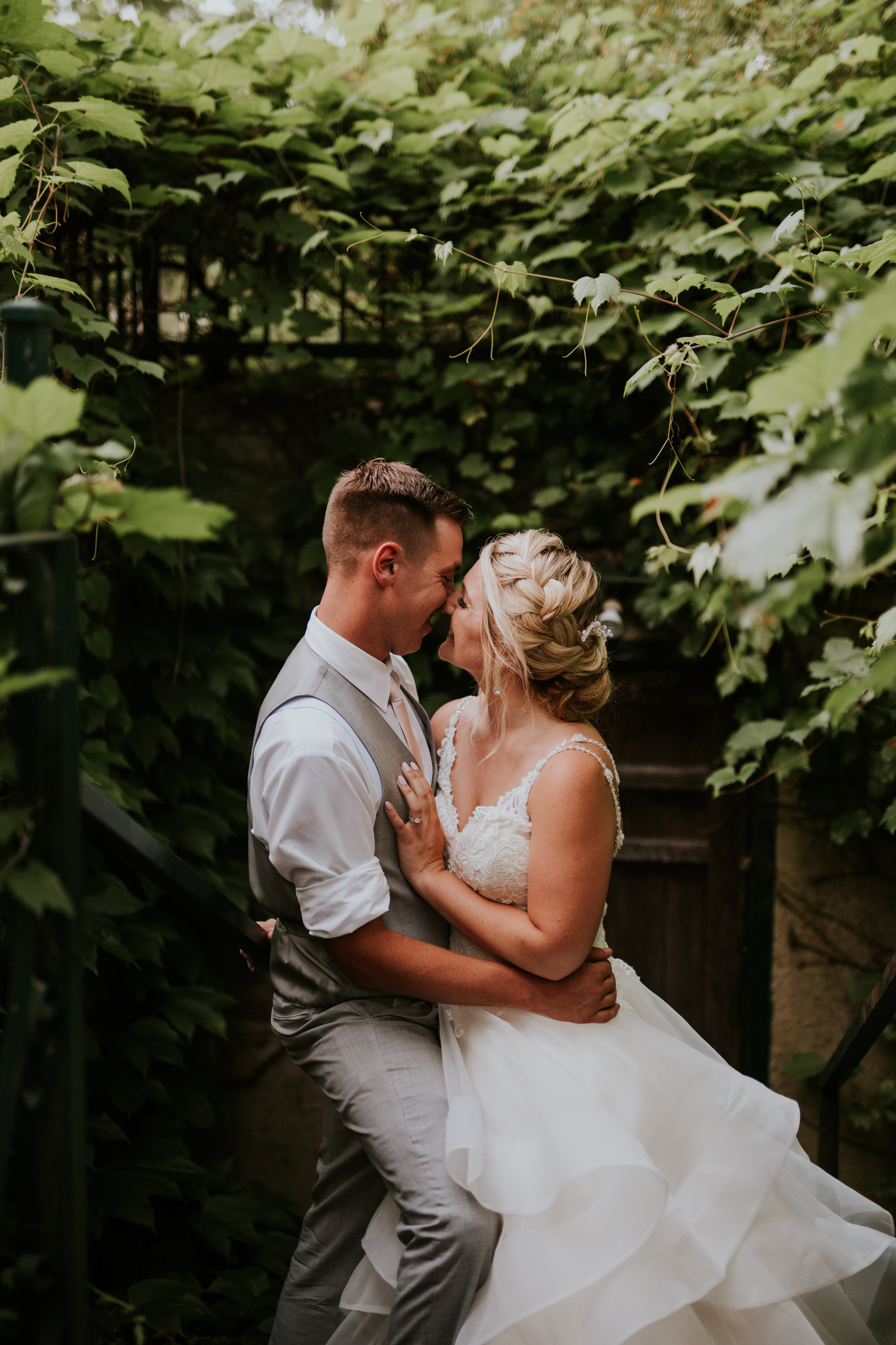 Elmhirst Resort Wedding - kissing on the stairs
