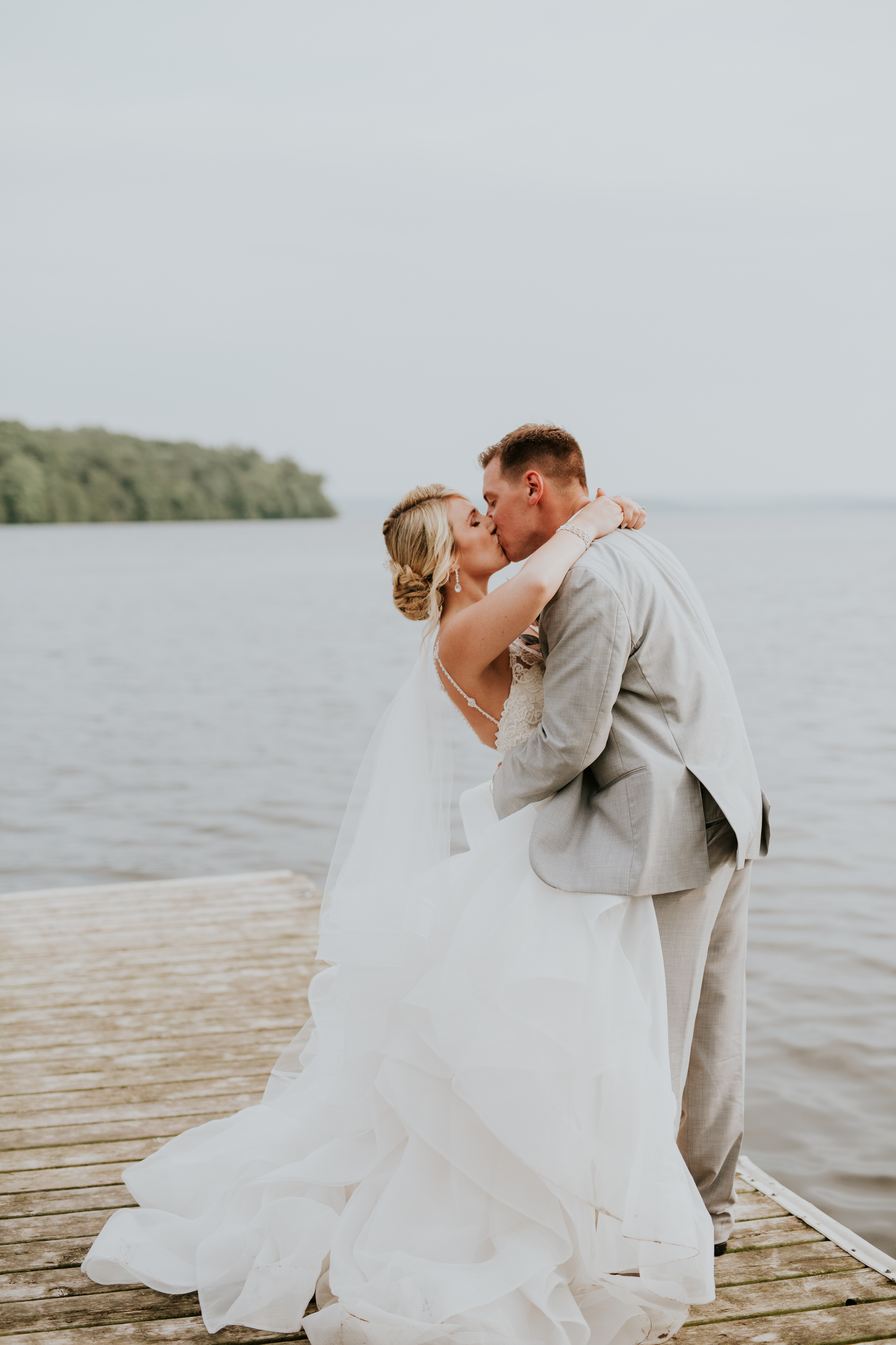 Elmhirst Resort Wedding - kissing on the dock